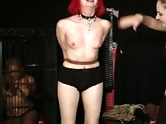 Alt girl is strung up and whipped as one more slave watches