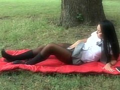 Long haired brunette schoolgirl receives fucked in a park
