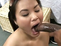 Asian innocent babe getting face fucked by a big dark cock !