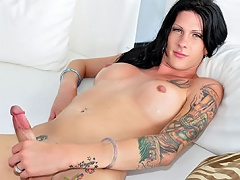 Tattooed ladyboy shows her ass a& cock and that babe enjoys it!...