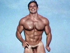 Very sexy & athletic gay model poses for the camera naked...