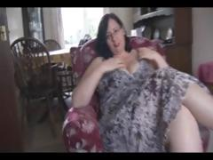 Fat aged brunette with huge boobs and ass sticks sex toy in her fur pie