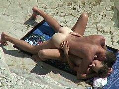 Dilettante couple on a beach