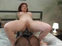 Sexy wench that loves anal fuck herself with a big black strap-on