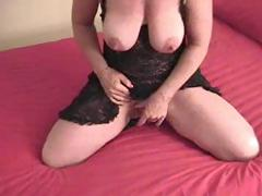 Busty mature with a very large love button is masturbating alone
