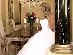 Bride in beautiful wedding suit spreading legs