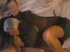 Charming Bridgette B wraps her lips round a huge cock