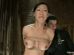 Asian sweetheart Tia Ling gets her lucious tits and steamy cunt teased while tied up