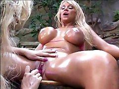 Oiled up bikini lesbians play outdoors