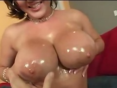 Big titty porn actress Claire Dames plays with her giant love melons and finger...