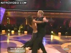Swarthy Beauty Cheryl Burke Dancing In a Revealing Darksome Dress