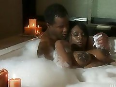 Pretty swarthy with huge tits does blowjob in bathroom
