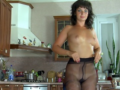 Gorgeous honey settles for black fashion hose to go with her navy blue...