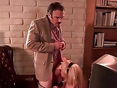 Sluty blonde with massive hooters gives blowjob to nerdy hunk in office