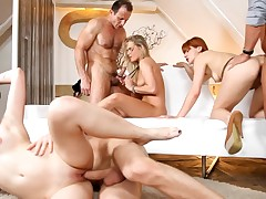 Swinging angels are having group fucking with their men around an fuckfest
