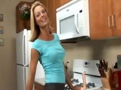 Busty Anilos Brenda James rides a knob on kitchen floor.