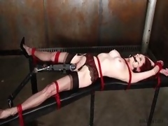 Emily Marilyn confined with a dirty black aperture