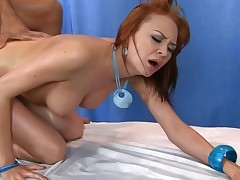 Fit masseur pounding his oiled up redheaded client
