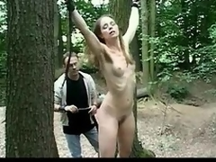 Scrawny comme ci lackey girl experiences a Psych gobbledegook twinkling bdsm game with reference to the forest