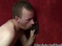 A white pauper sucks and strokes a frowning clothes-horse about a gloryhole