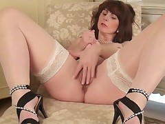 Mommy in hot stockings rubs her pussy just