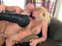 Blonde close by high boots finishes her man off with a rusty trombone