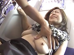 Adult Japanese woman being caressed on a train ride